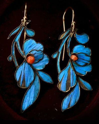 Earrings encrusted with blue kingfisher feathers: