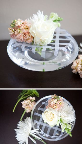 Flower arrangement trick for wide opening bowls and round/fish bowl vases. Sticky tape can solve the world's problems!