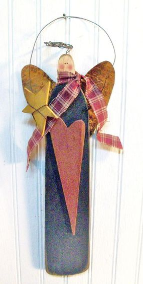 Primitive and Folk-art Style Christmas Angel with a Heart. Vintage from Estate Sale. Metal, Wood, and Cloth. Awesome.. $9.99, via Etsy.: